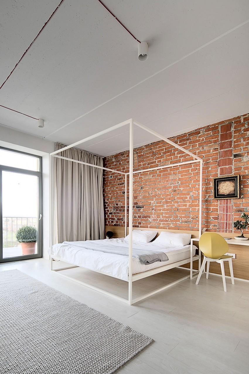 Spavaca soba sa nemalterisanim zidom